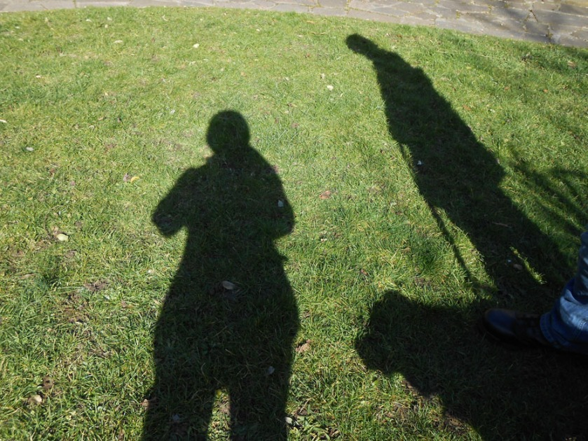 Three Shadows and a Boot